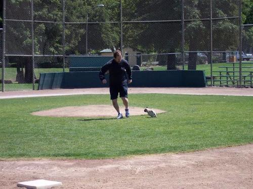 Little Sheba and Tim running at the little league field