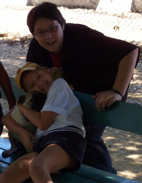 Adam and Julia hugging Sheba