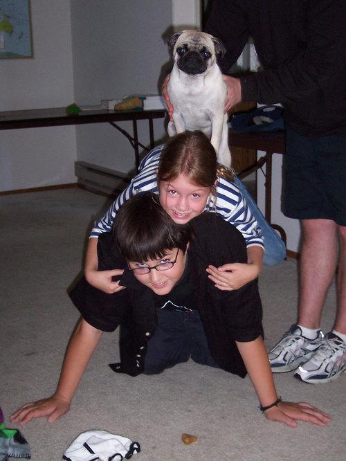 Adam, Julia and Sheba make a pyramid
